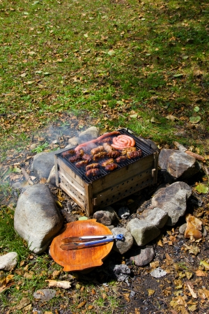 Preparing romanian meat specialties on barbecue Stock Photo