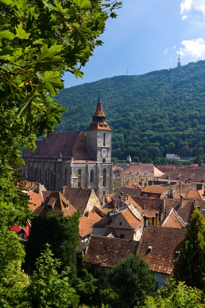 Beautiful medieval town of Brasov in Transylvania , Romania with the gothic Black Church Stock Photo