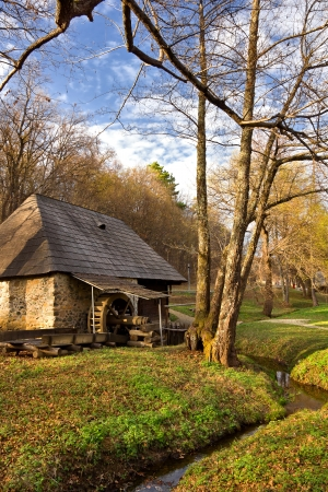 watermill: Watermill and creek in the forest Stock Photo
