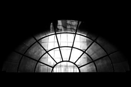 Semi round church window on black and white