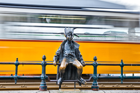 Little Princess (Kiskir?lyl?ny) statue sitting on the railings Editorial