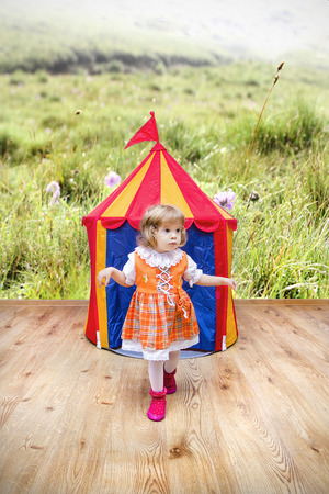 inocent: Little swiss girl getting out of the tent