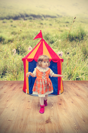 inocent: Little Heidi girl getting out of the tent Stock Photo