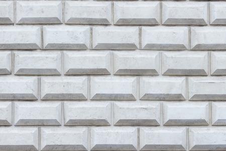 Exterior wall background with big grey bricks texture