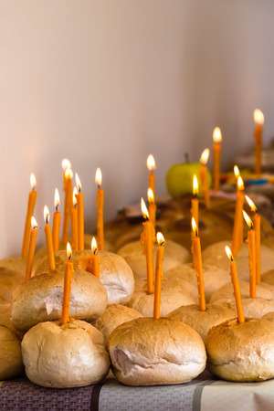 commemoration: Breads with lighted candles for the living in memorial of dead people as part of commemoration ritual in orthodox religion