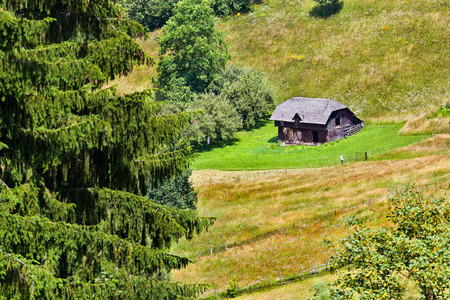 Sheeps wooden shelter in the mountains Stock Photo