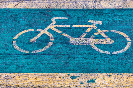 Bicycle lane with yellow byke signe on green background