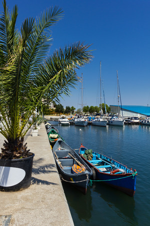 Old wooden fisherman boats docked in the Tomis touristic harbor in Constanta Romania Stock Photo