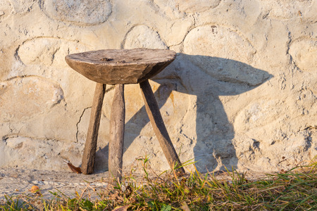 Old traditional wooden chair in romanian countryside