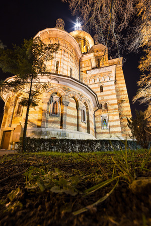 impressive: Impressive orthodox cathedral in old town center of Timisioara Romania by night Stock Photo