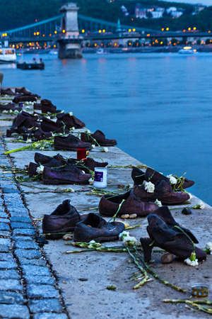 BUDAPEST, HUNGARY - APRIL 2, 2015: Iron shoes memorial to Jewish people executed World War 2 in Budapest Hungary Redakční
