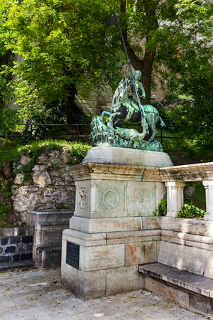 Bronze statue of St George having the epic battle with the dragon in Budapest Hungary