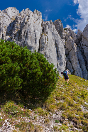 Single young man visiting Piatra Craiului Mountains in the Southern Carpathians in Romania Editorial