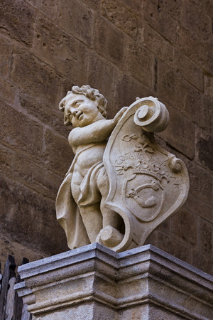 Medieval style statue with a little boy and shield in Alba Iulia city center