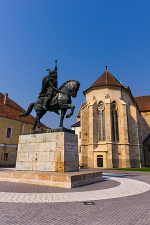 Statue of a famous romanian medieval lord in Alba Iulia old town center Editorial