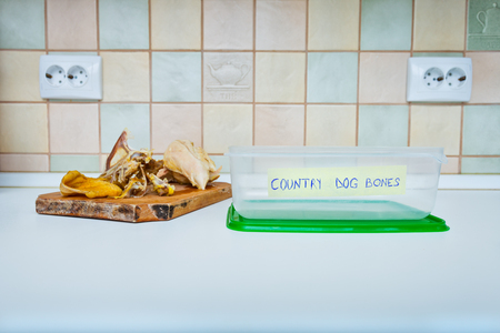 Specific plastic container for bones left after lunch, for dogs Stock Photo