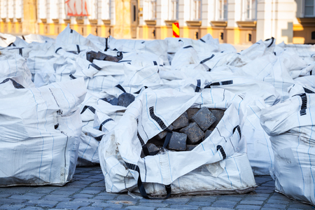 Big plastic bag full with cobblestones for pedestrian zone restauration Stock Photo