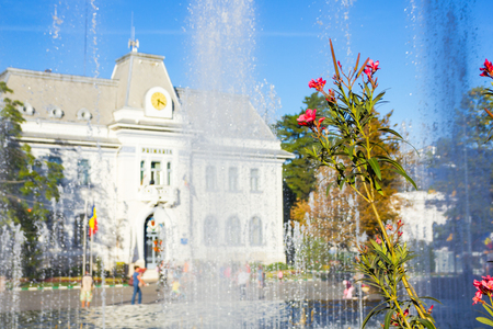 Flowers and fountain in front of Pitesti town hall, Arges county, Romania