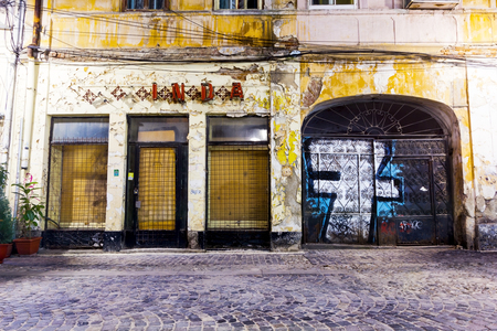 Bucharest, Romania - September 15, 2012: Lipscani area by night, in Bucharest, before old town center restoration Editorial