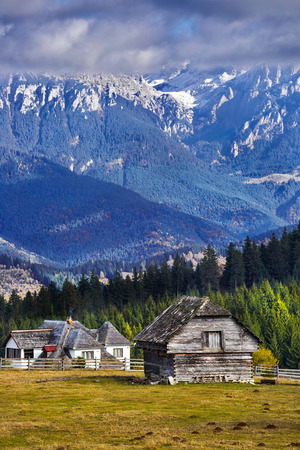 Bucegi mountains in Romania Carpathians with village houses in autumn Stock Photo