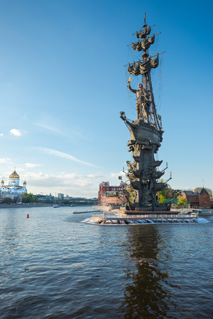 Moscow river embankment in Moscow, Russia with the statue of Petr I , against blue sky
