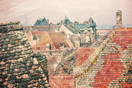 Historical old buildings roofs in Sibiu Romania as vintage postcard Stock Photo