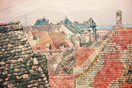 Historical old buildings roofs in Sibiu Romania as vintage postcard 免版税图像