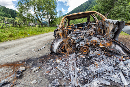 Vehicle burned to the metal near a country road