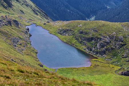 Small glacial lake Buda in Fagaras mountains close to Transfagarasan road Stock fotó