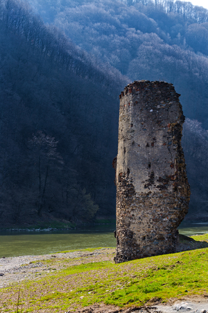 Medieval broken tower. Archaeological site on the Olt valley in Carpathian Mountains.