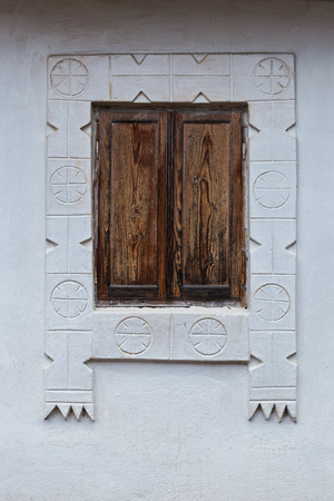 Window with wooden shutters closed of a romanian traditional house