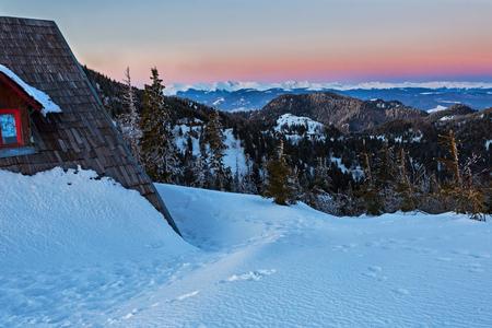 Spectacular view at dusk on Fagaras mountains from Cozia mountain peak