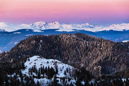 Picturesque mountain landscape during winter in Fagaras mounntain range, tallest in Romania Carpathians, at sunset
