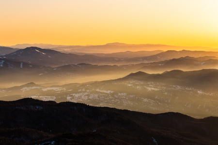 Carpathians mountains range covered by sunrise sun