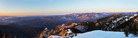 Winter panorama from Cozia peak on Olt river and Builla Vnaturarita mountains Stock fotó