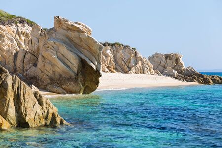 Exotic Platanitsi beach in Sarti, Sithonia, Greece with crystal clear water and spectacular shapes of rocks Stock Photo