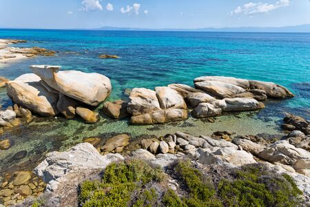 Exotic Platanitsi beach in Sarti, Sithonia, Greece with crystal clear water and spectacular shapes of rocks - the whale