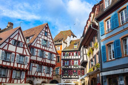 Colmar, France - September 28, 2019: Old town of Colmar, Alsace, France. View with colorful buildings, streets, canal and flowers. Colmar, France. Petite Venice, water canal and traditional half timbered houses.