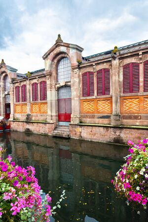 Covered market of Colmar (Le marché couvert), Alsace, France, on the river