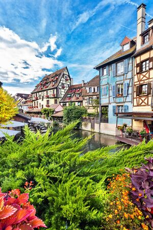 Old town of Colmar, Alsace, France. View with colorful buildings, streets, canal and flowers. Colmar, France. Petite Venice, water canal and traditional half timbered houses.