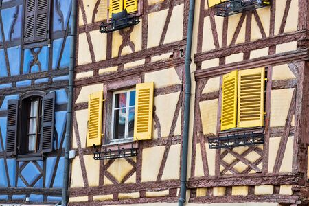 View with colorful traditional half timbered houses in Colmar, France. Standard-Bild