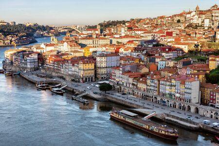 View of the city of Porto from the Eiffel Bridge early in the morning at dawn, small multicolored houses of the Ribeira Quarter Archivio Fotografico - 150264001