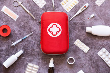 Home first aid kit, pills, thermometer on plain background Reklamní fotografie