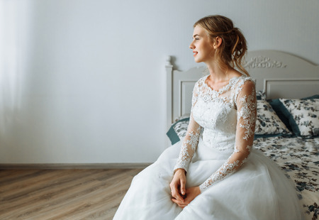 Beautiful Bride In Wedding Dress. Morning In The Bedroom Of The ...