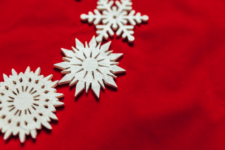 Snowflakes on a red background. Christmas toy drive. Beautiful photo Stock Photo