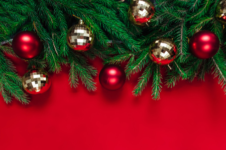 Christmas background. Balls of gold and red. Toys. The red background. Gold beads Archivio Fotografico