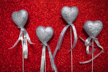 red shiny background with silver hearts, love, Valentines Day, texture abstract background, romantic picture, suitable for advertisement, insert text, Stock Photo