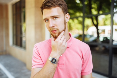portrait of handsome young man with beard in town returning after school or work Stock fotó