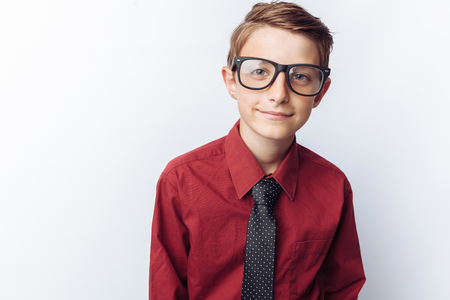 Portrait of a positive teenager on a white background, glasses, red shirt, advertising,