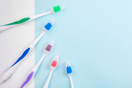 Toothbrushes on light blue background, close up different kinds of Toothbrushes, new not used, isolated